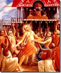 Lord Chaitanya dancing in front of Lord Jagannatha