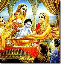 Women tending to baby Krishna