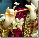 Krishna holding flute