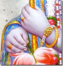 Krishna holding flute and flower