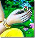 Sita holding Rama's ring