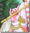 Krishna holding His flute