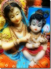 [Mother Yashoda holding Krishna]
