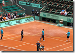 [watering clay court]