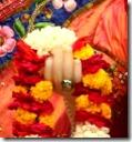 [Radharani holding flower garland]