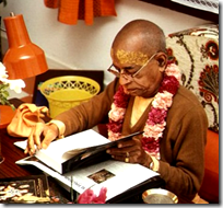 [Prabhupada with his books]